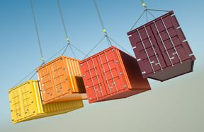 four shipping containers suspended in air