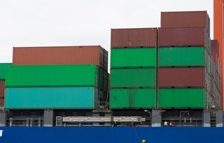 containers of various sizes on a cargo ship