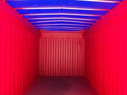 Interior of an open top container with tarp roof on.
